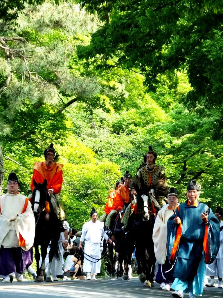 the procession under the fresh green trrees