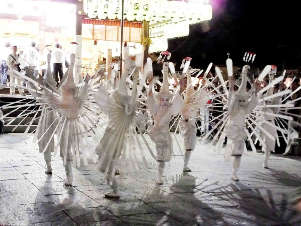 children in costumes of egrets