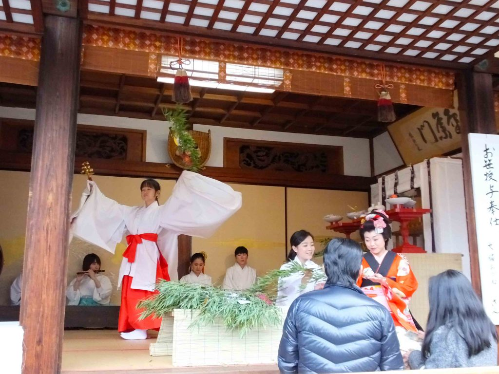 the dancing shrine maiden behind it