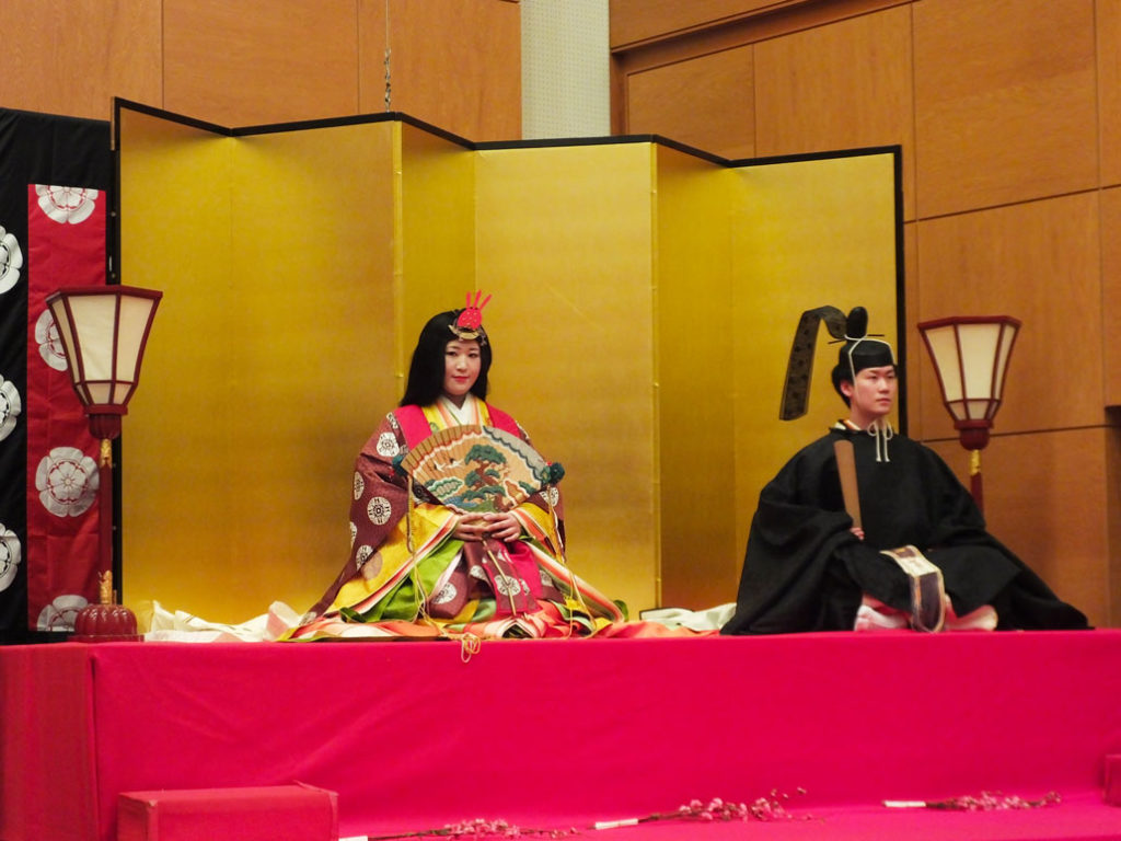 "the ""obina"" and ""mebina"" sitting on the hinadan"