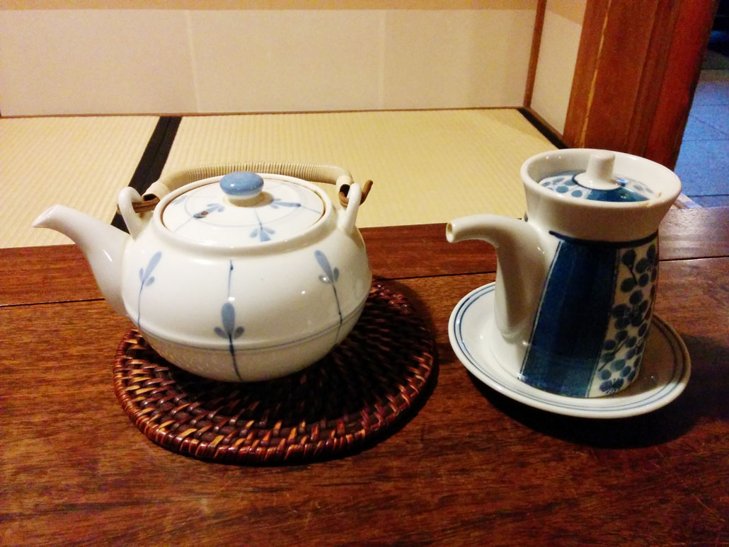 a teapot (left) and a sauce bottle (right)